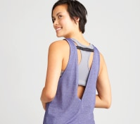 Layered purple and grey yoga top with strap detail.