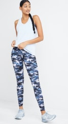 Activewear outfit including a white tank top and blue camo leggings.