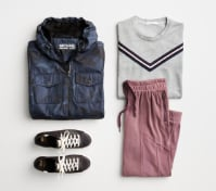 Activewear outfit including a blue windbreaker jacket, white striped tee, sneakers and pink jogger pants.