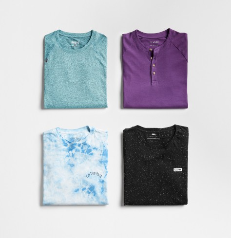 Men's workout tops in teal, purple, tie-dye and black.