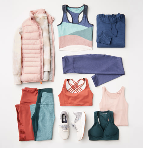 Plus size workout clothing including a pink puffer jacket, and various activewear tops and bottoms, plus sneakers.