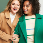 Plus size clothing including brown and green coats over light colored tops.