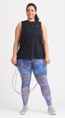 Plus size activewear clothing including a black muscle tee and blue leggings.