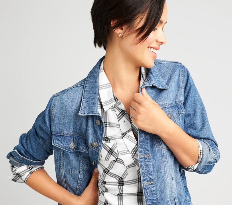 Plaid shirt under a denim jacket.