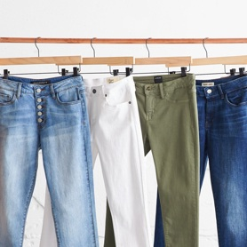 Four pairs of pants in various colors.