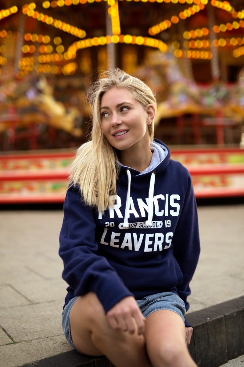 Model wears our Chunky Hoodie in navy colour with large printed leavers design