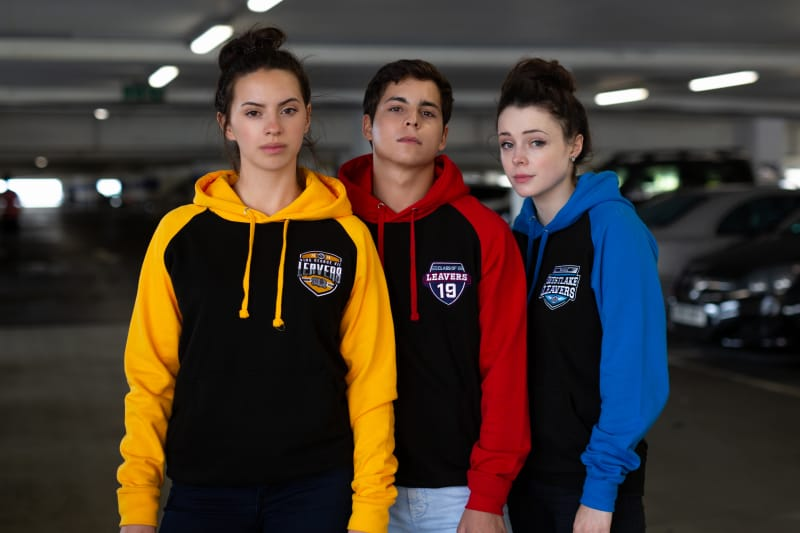 Models wear our Baseball Hoodie with embrodiered leavers logos
