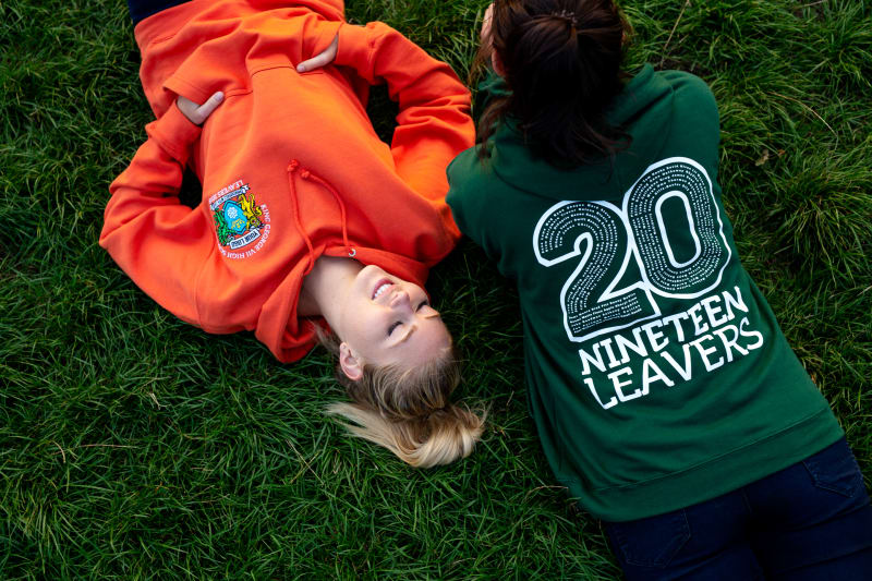 Models wear our College Hoodies in burnt organge and bottle green