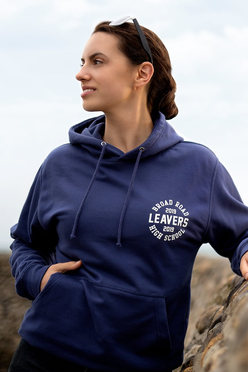 Model wears our College Hoodie in denim blue colour with small printed leavers logo