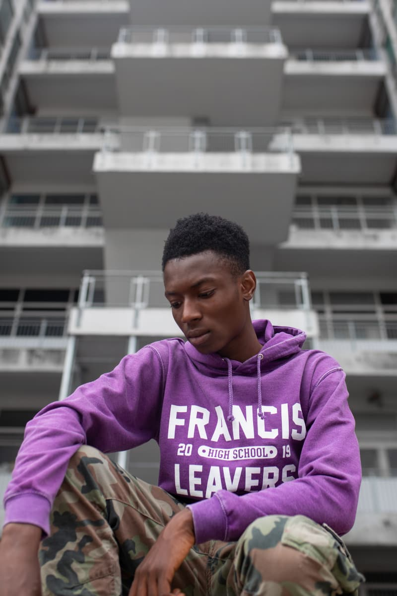 Model wears our Washed Hoodie in purple with a large printed leaveres design