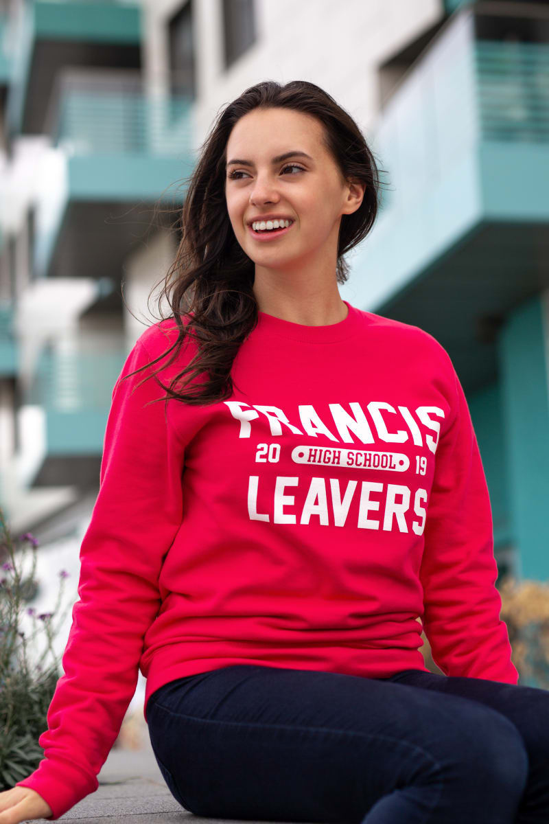 Model wears our College Sweatshirt in lipstick pink colour with large printed leavers design