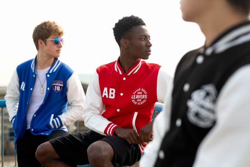 Models wear our Varisty Jackets in royal blue, fire red and jet black colour