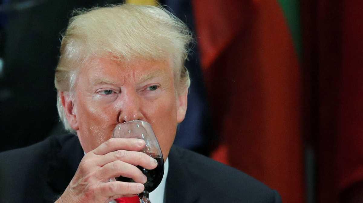 Trump drinking wine