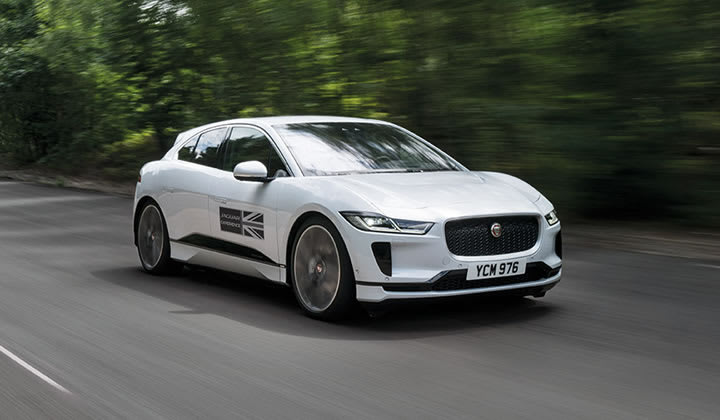 Jaguar all-electric I-PACE SUV driving on track