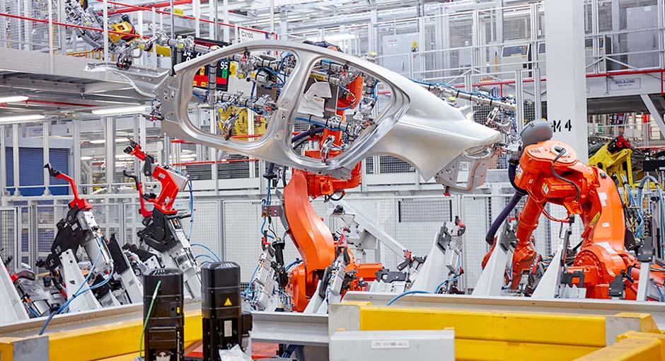 Jaguar XE being built by manufacturing robots at Jaguar Castle Bromwich
