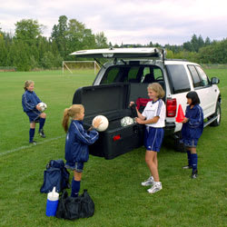 Soccer team using the StowAway Standard Cargo Carrier to pack up their equipment