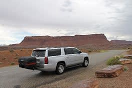 Stowaway cargo carrier on white SUV in Utah