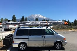Stowaway cargo carrier on a  Eurovan on a mountain trip