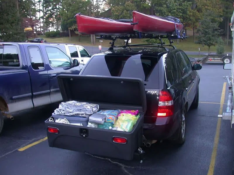 Acura MDX SUV with a Stowaway Standard Cargo Box with lid open