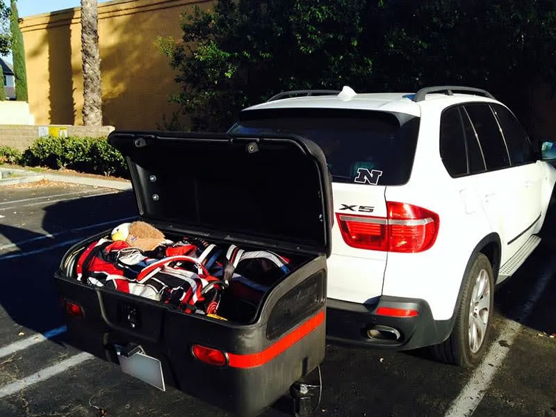 BMW X5 SUV with a Stowaway MAX Cargo Box with lid open