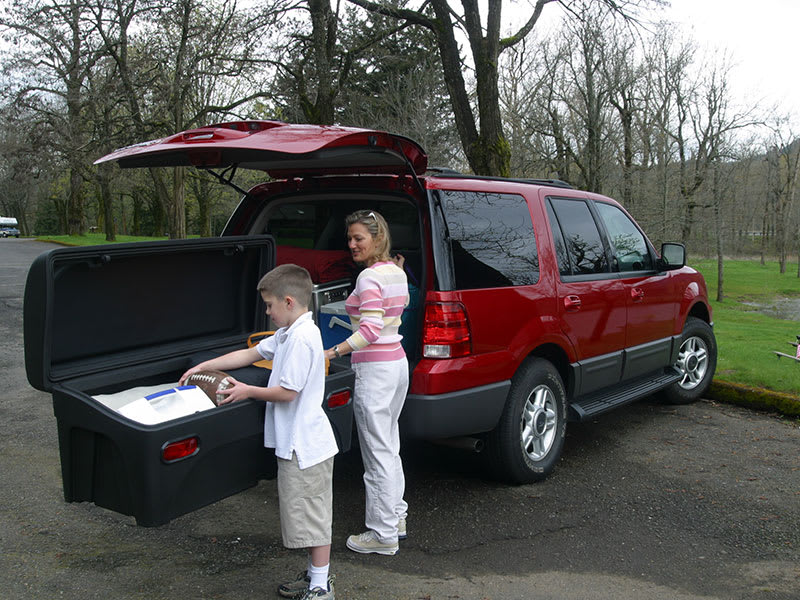 Stowaway Cargo Carrier - boy and mom travel for holidays