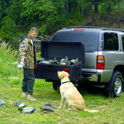 Duck hunter using the StowAway Standard Cargo Carrier to store his decoys and hunting gear