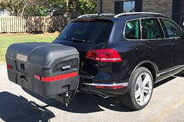 Stowaway cargo carrier on black Volkswagen Touareg