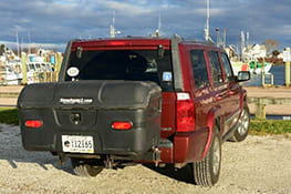 Stowaway cargo carrier on red Jeep on sand