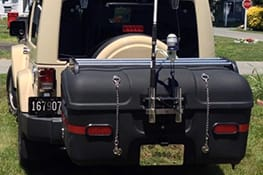 Stowaway cargo carrier on a beige Jeep
