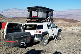 Stowaway cargo carrier on a white Jeep in Death Valley