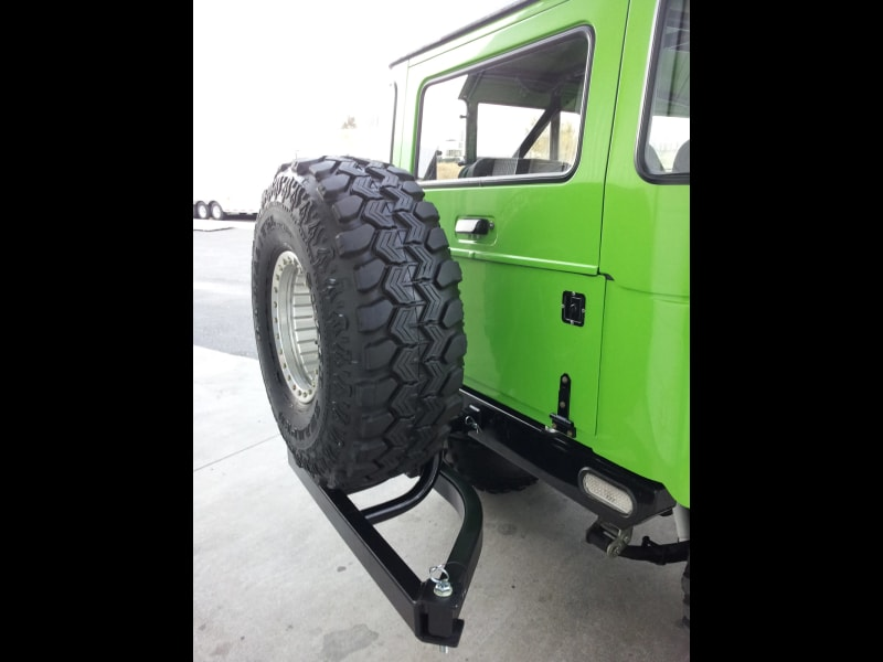 Green Jeep with StowAway Spare Tire Holder