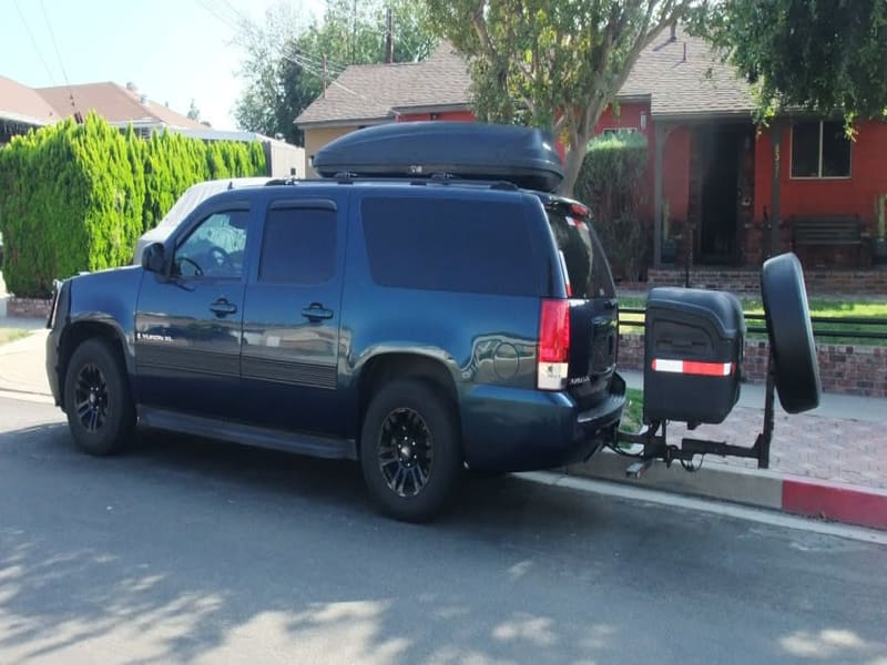 Chevy Suburban with StowAway Max Cargo Boxnd Extended Spare Tire