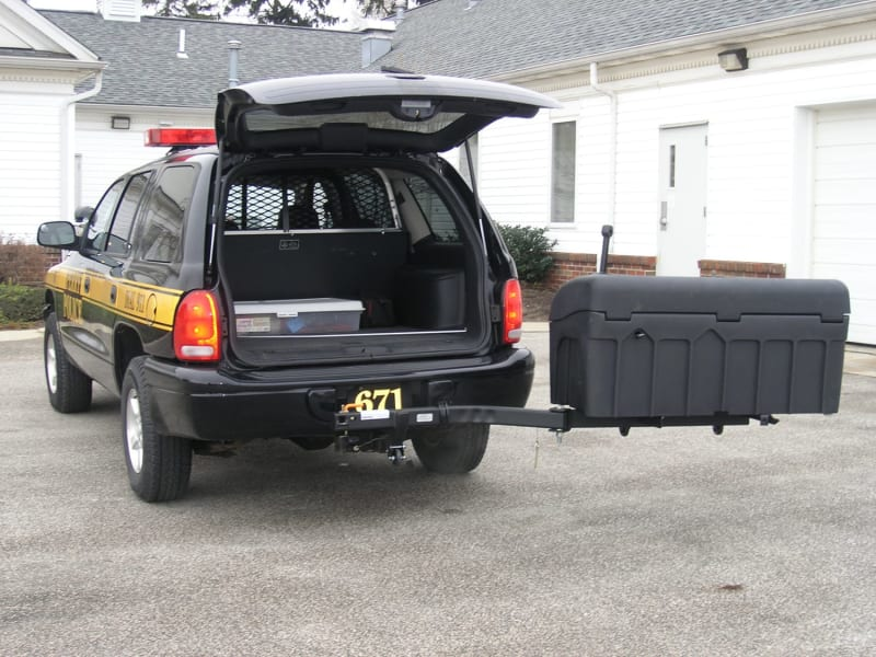 StowAway Standard Hitch Mount Cargo Carrier on Dodge Police Vehicle in Swung-Out Position