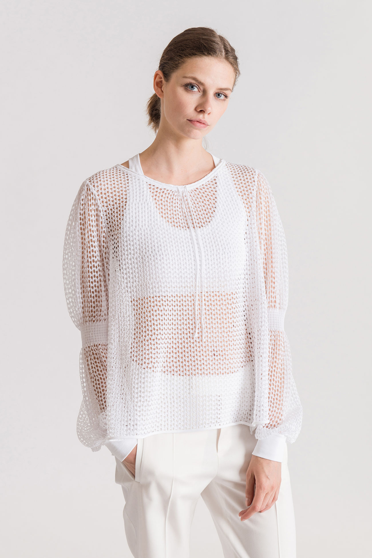 Feminine jumper with a hole pattern