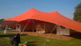 An installation of our large orange tent for the travelling bear circus