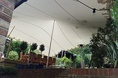 birthday party attached to house garden decking white stretch tent dulwich london