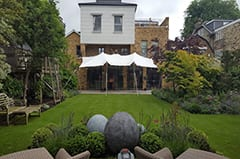 london attached to house white stretch tent garden party