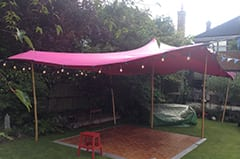 The use of a stretch tent to cover a dance floor