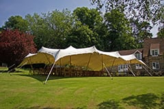 white stretch tent tables and chairs garden party kent