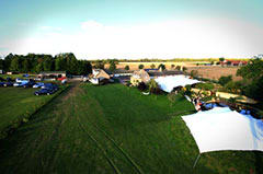 Aerial photo of stretch tents in action at a wedding