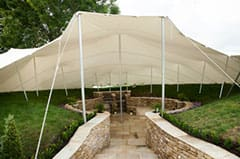 Stretch tent covering a BBQ pit