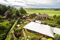 wedding white stretch tent scotland walled garden drone aerial credit hewie dalrymple photography