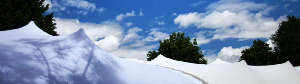 cloudy blue sky over a stretch tent
