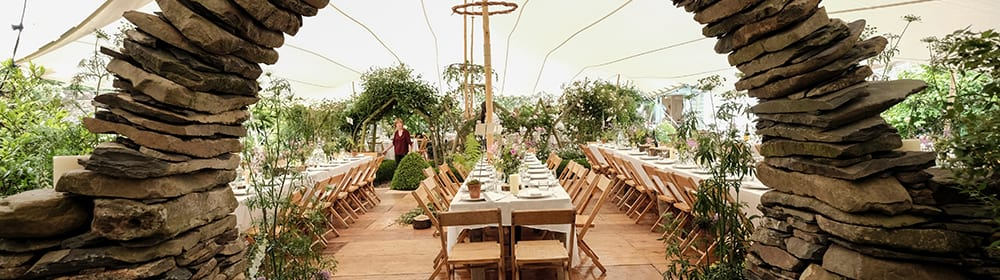 wedding white stretch tent slate moon gate rustic tables and chairs scotland credit nic barlow