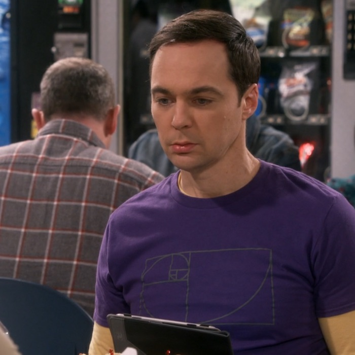 Another photo of Sheldon Cooper from Season 12 with golden spiral t-shirt