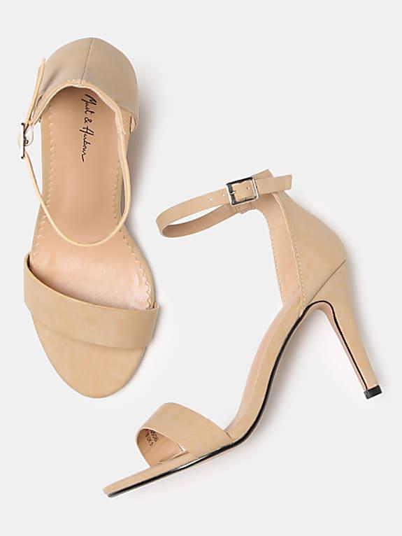 women beige solid heels