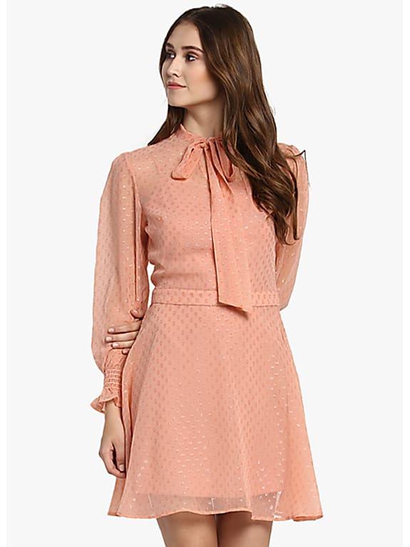go for  peach embellished skater dress