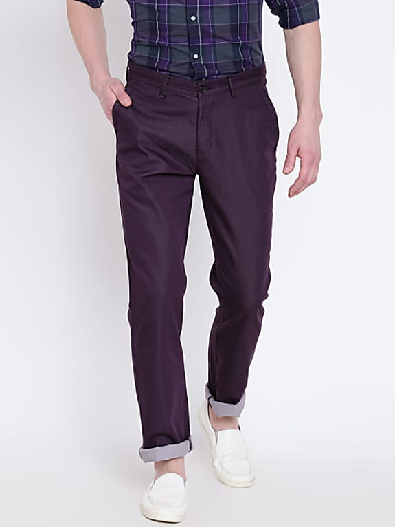 men purple sharp fit solid regular trousers