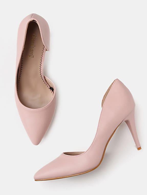 women pink solid pumps