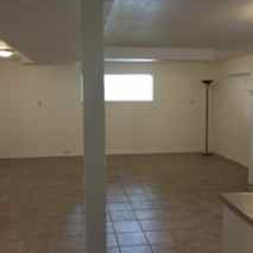 Large tiled Living Room / Kitchen Area